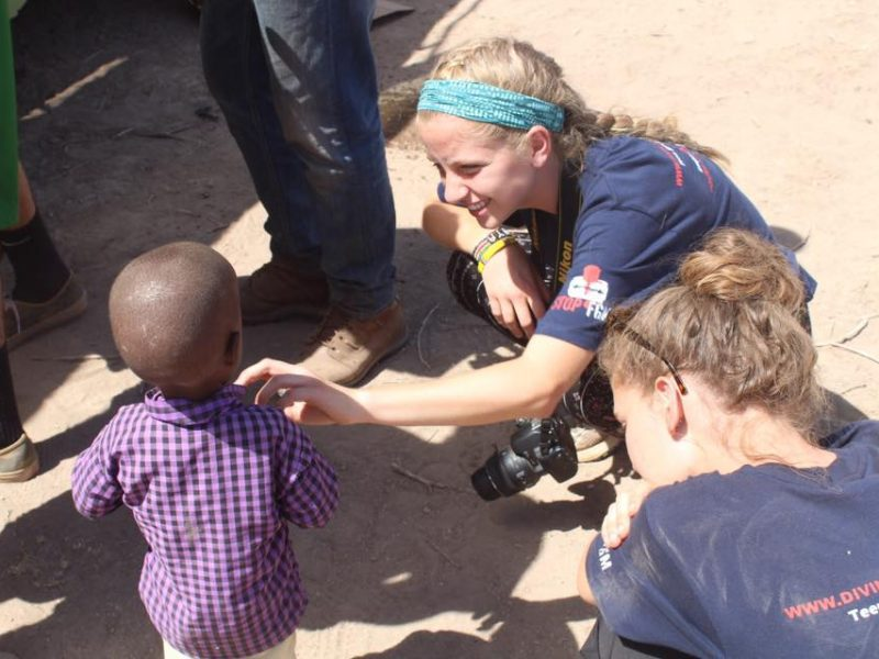 Kenya student group with child